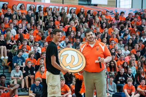 Mr. Tim Barry presenting the Junior Class president with the spirit shield